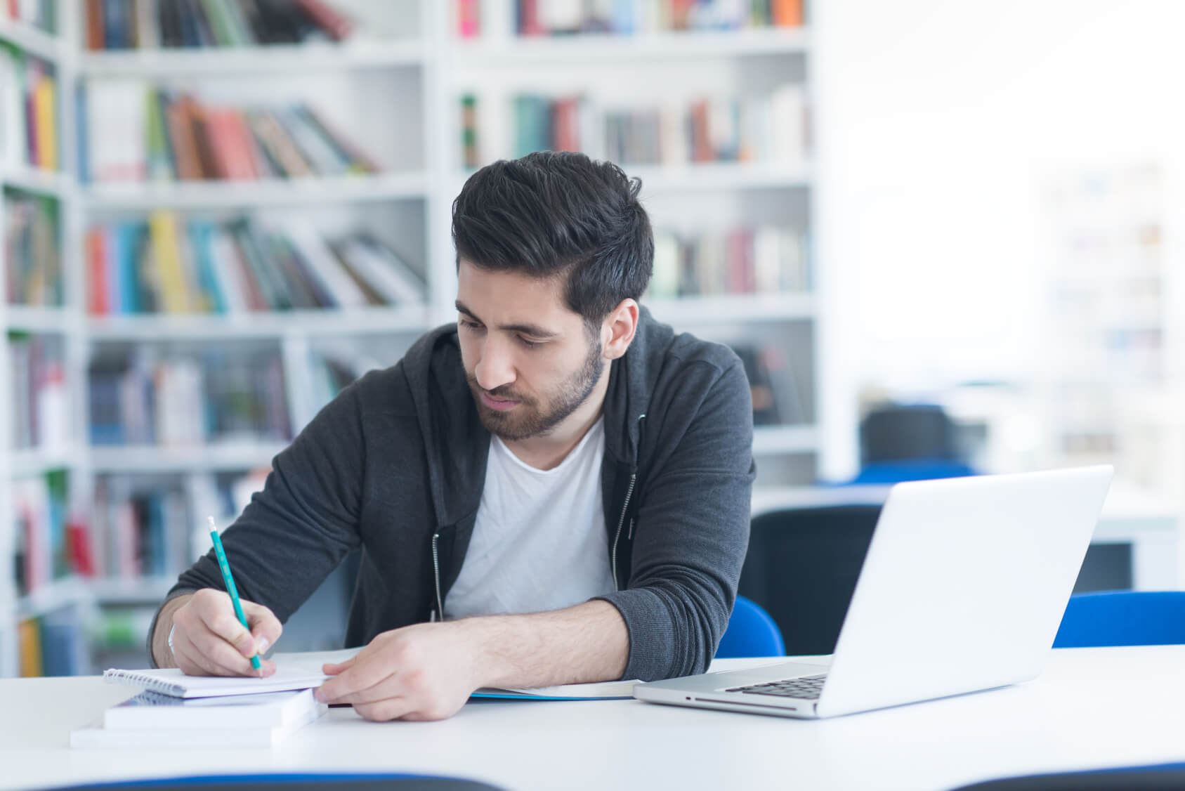 Image of boy student writing an essay